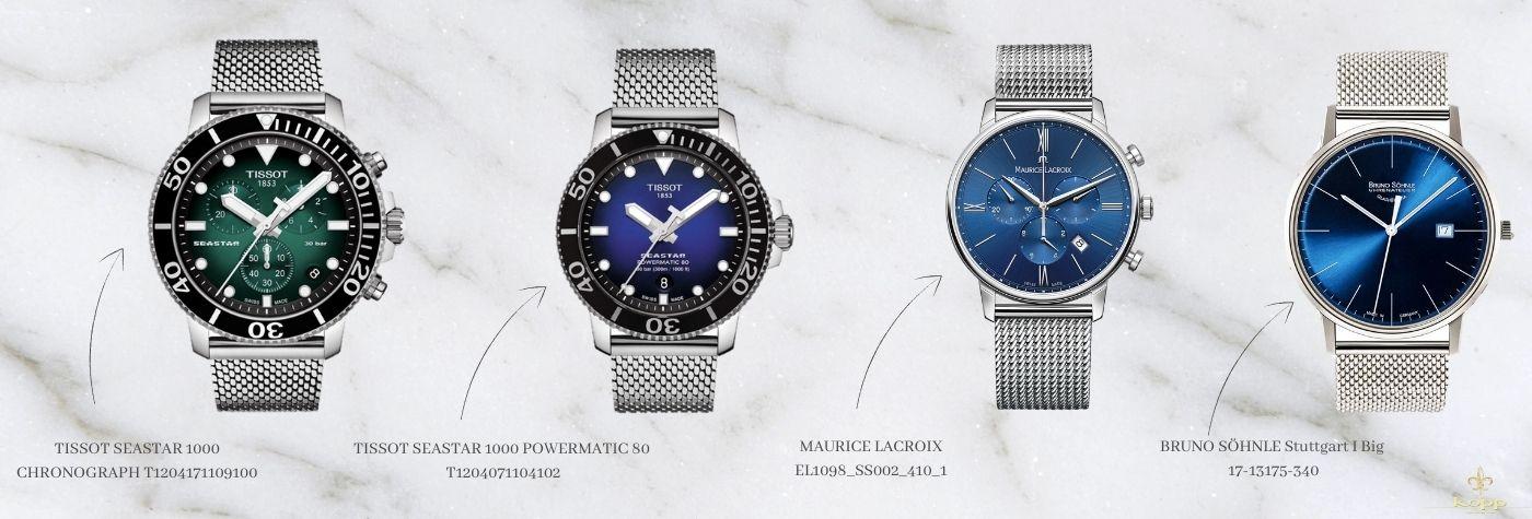 Verschiedene Milanaise Uhren auf einem weißen Marmorhintergund