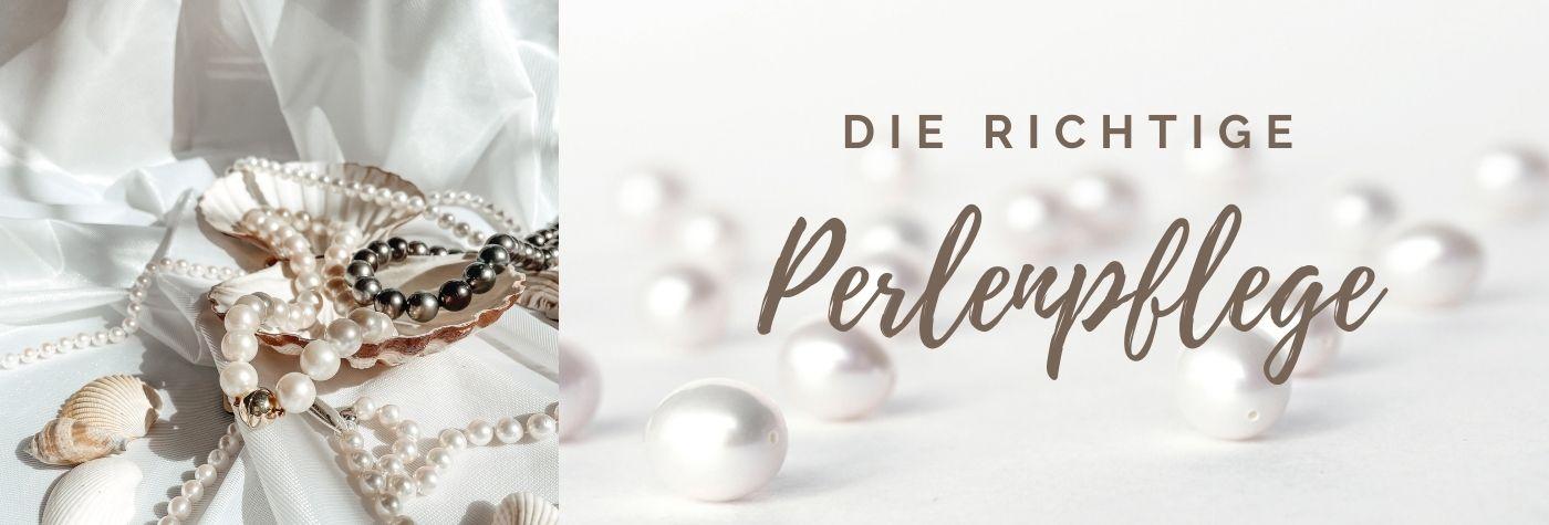 Perlenketten in einer Muschel auf einem weißen Tuch